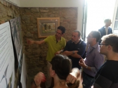 <p>Reception and Exhibition - Mayor of Volterra Marco Buselli discusses one of the projects with other members of the Comune and Volterra residents<br> Photo Credit: Wladek Fuchs</p>