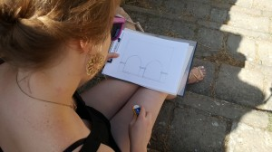 A student drawing an elevation plan of the Fonti