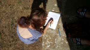 A student drawing a plan of the Fonti